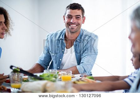 Man having breakfast with family at home