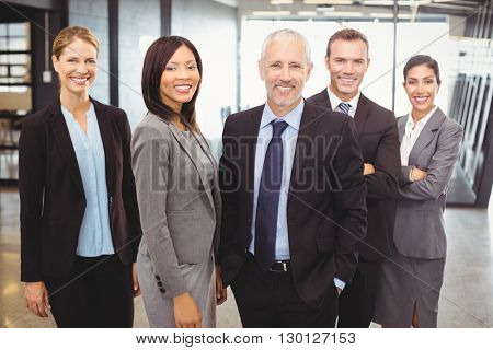 Portrait of businesspeople standing and smiling in office