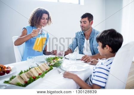 Family sitting at breakfast table in dinning room