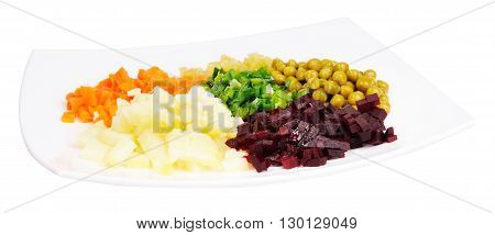 Cooked vegetables salad on porcelain plate isolated on the white background