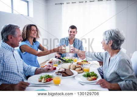 Happy family having breakfast together at home