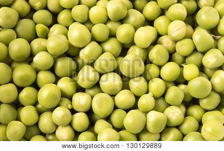 Fresh green Peas as background close up view