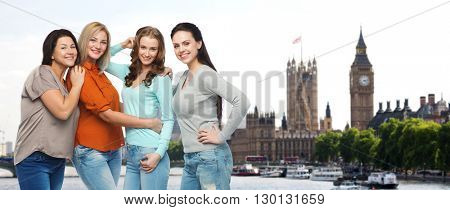 friendship, travel, tourism, diverse and people concept - group of happy different size women in casual clothes over london city and big ben tower background