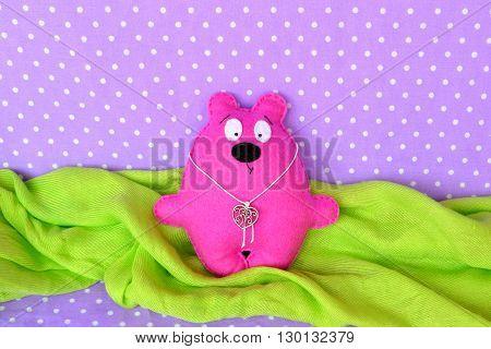 Funny pink soft Teddy bear. Stitched felt toy