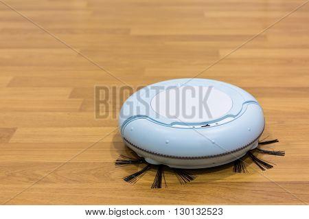 Close up robotic vacuum cleaner on the floor.