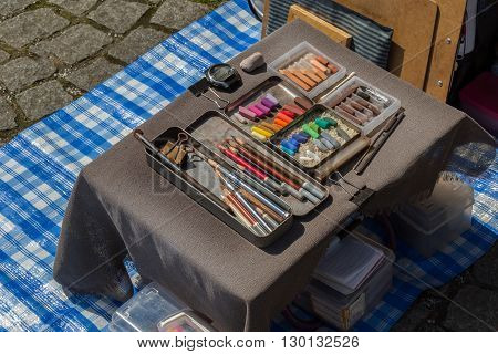 Painting set of used chalk colors with colour pencils and rubber on table.