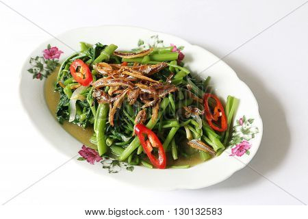 Stir fried Kang with fried anchovice and chili