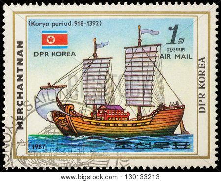 MOSCOW RUSSIA - MAY 17 2016: A stamp printed in DPRK (North Korea) shows image of Korean sail ship of Koryo period (918-1392) and flag of DPR Korea series