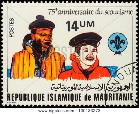 MOSCOW RUSSIA - MAY 14 2016: A stamp printed in Mauritania shows two scouts in naval uniform series