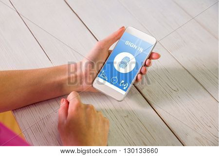 Woman using smartphone against yellow medical background with ecg line