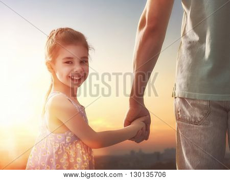 Happy loving family. Father and his daughter child girl playing outdoors. Cute little girl and daddy. Concept of Father's day.