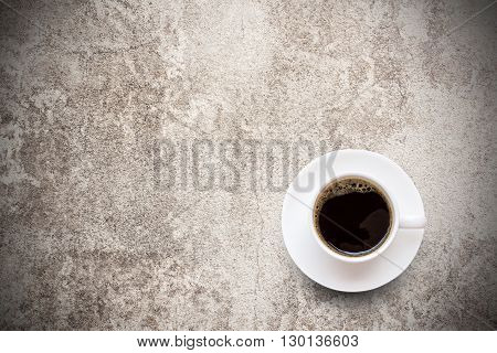 Coffee cup on grunge background. top view