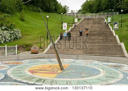 Svetlogorsk, Russia - June 25, 2010: Mosaic sundial at foot of stairs on boardwalk, with diameter of 10 meters with 12 divisions of the zodiac signs