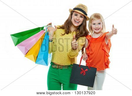 Happy Mother And Daughter With Shopping Bags Showing Thumbs Up