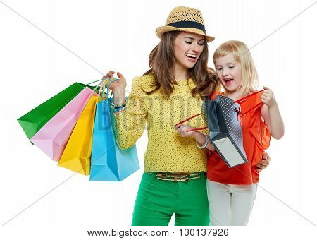 Portrait Of Mother And Daughter Looking Inside Shopping Bag