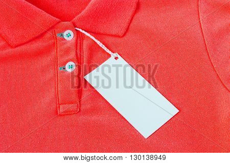 Closeup of blank tag label on red shirt