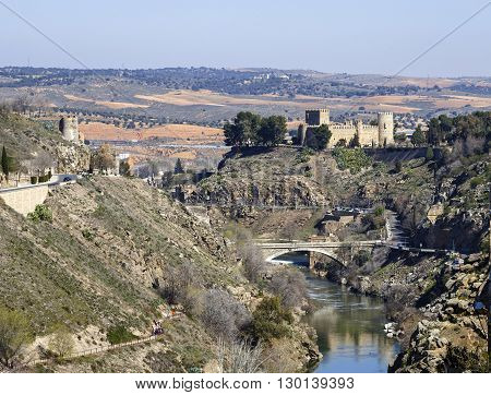 Toledo Spain - March 13 2016: San Servando Castle is located in the city of Toledo Spain along the banks of the Tagus River and the Infantry Academy. In 1874 he was declared a national artistic monument.