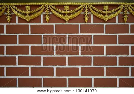 The wall show a pattern of bricks used as material.