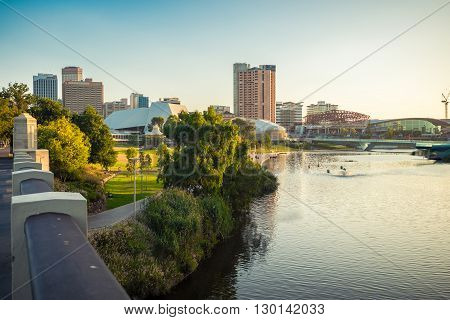 Adelaide Australia - January 3 2016: Adelaide city skyline with Torrens river viewed across the Elder Park on a summer evening