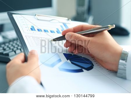 Stock market graphs monitoring. Business adviser analizing financial statistics