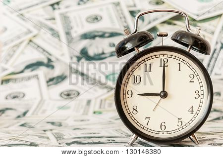 Time is money, clocks under background of american dollars