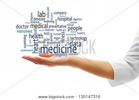 Female doctor hand with word cloud. Medical concept