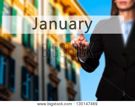 January - Businesswoman Hand Pressing Button On Touch Screen Interface.