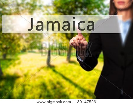 Jamaica - Businesswoman Hand Pressing Button On Touch Screen Interface.