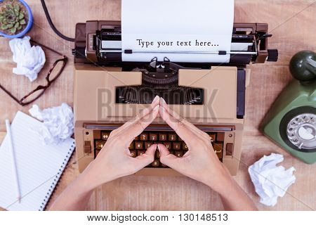 Type your text here... message on a white background against above view of typewriter and old phone