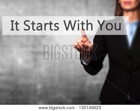 It Starts With You - Businesswoman Hand Pressing Button On Touch Screen Interface.