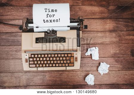 Time for taxes! message against view of an old typewriter and paper