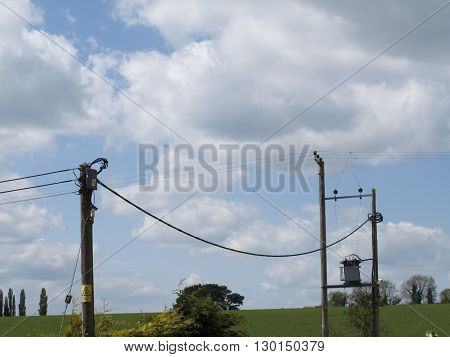 Telephone communication infrastructure post and wires across farmland