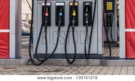 Hoses at a petrol station close up