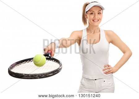 Cheerful female tennis player holding a racket and a ball isolated on white background
