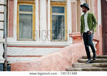 Fashion Portrait Of Black African American Man On Green Velvet Jacket And Black Hat Stay On Stairs B