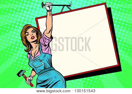 Advertising girl with poster pop art retro style. female worker with a hammer nailed to a wall billboard.