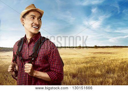 Asian Man Wearing Hat Travel Alone