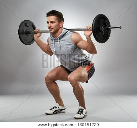 Man Doing Squats With Barbell