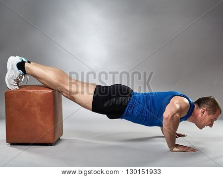 Man Doing Pushups At Incline