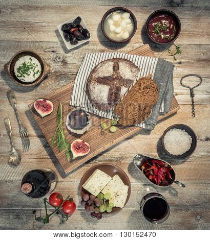 wine with vegetables, fruits and cheeses with bred on wooden table top view