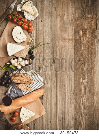 French food ingredients on a wooden table with space for text