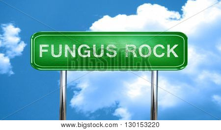Fungus rock vintage green road sign with highlights