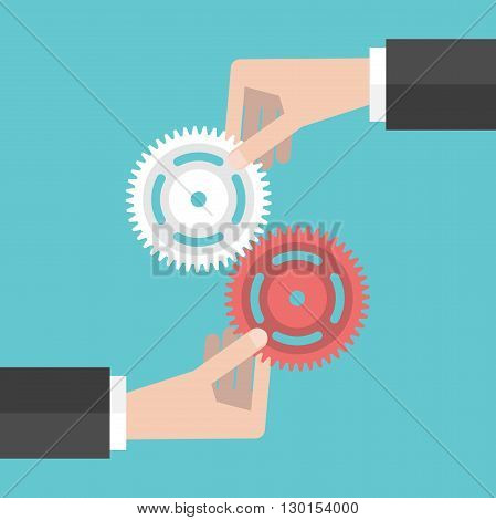 Two Hands Holding Gears