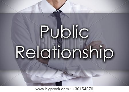 Public Relationship - Young Businessman With Text - Business Concept