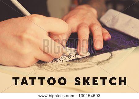 Tattoo machine, sketch and tattoo supplies, close up
