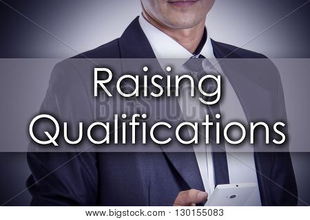 Raising Qualifications - Young Businessman With Text - Business Concept