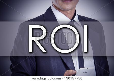 Return On Investment Roi - Young Businessman With Text - Business Concept