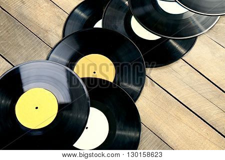 Vinyl records on wooden table
