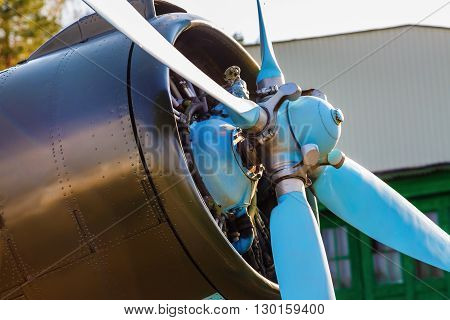 Aircraft propeller and engine close-up. Vintage plane. Old retro plane close-up. Selective focus.