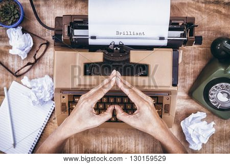 Brilliant message on a white background against above view of typewriter and old phone